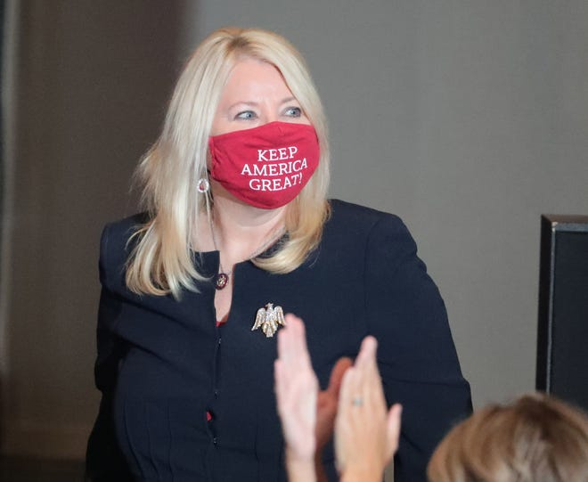"""Rep. Debbie Lesko, R-Ariz., wears a mask while Vice President Mike Pence speaks to supporters at a """"Latter-day Saints for Trump"""" campaign event in Mesa, Ariz. August 11, 2020. It was his second stop in the battle ground state after visiting Tucson earlier in the day."""