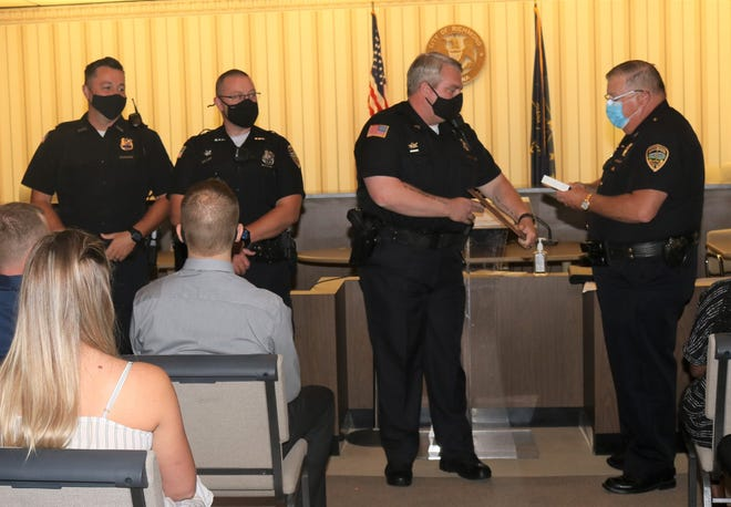 Sgt. Zach Taylor (from left), Officer William Purcell and Sgt. Austin Lipps receive Richmond Police Department's Life Saving Award from Chief Mike Britt during a Monday ceremony.