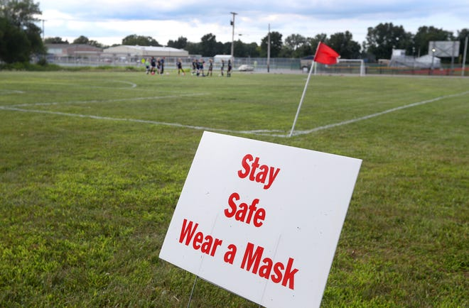 There are signs at the edges of the fields asking players and parents to wear masks and to practice social distancing at the Lakefront Soccer Club facility in Webster.