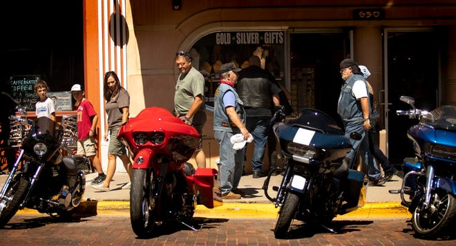 Rally-goers check out the bikes and shops in downtown Sturgis at the 80th Sturgis Motorcycle Rally this week.