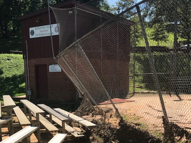 Flooding at Kiwanis Field in Gypsy Hill Park left the pitchers mound moved to the backstop, fencing collapsed, and first base bleachers moved.