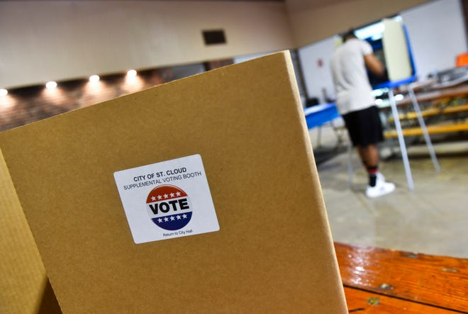 Voters cast ballots during primary voting Tuesday, Aug. 11, 2020, at Riverside Park in St. Cloud.