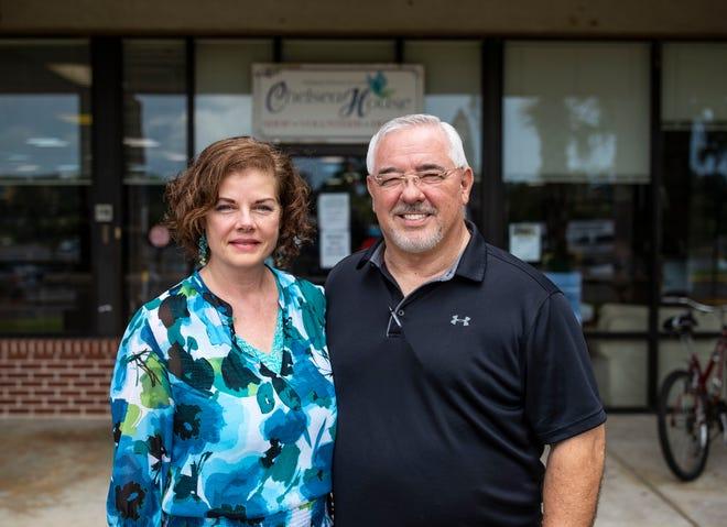 Beth Burns, co-founder of Good Samaritan Network and Chelsea House, left, and her husband, Glenn Burns, pose for a photo outside the Good Samaritan Thrift  Store.