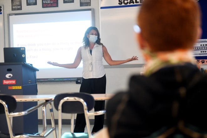 Eighth-Grade English teacher Erica Smith instructs her students what is expected of them in class on Tuesday, Aug. 11, 2020, on the first day of school at Stuart Middle School. Of the 817 students enrolled at the school, 42 percent of the population decided to do remote learning.