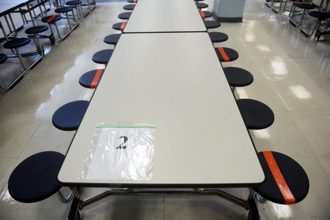 Students are given designated seating areas during the three lunch sessions on Tuesday, Aug. 11, 2020, on the first day of school at Stuart pMiddle School in Stuart.