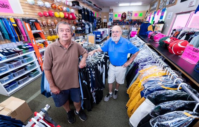 Midtown Sport owners Scott Chandler, left, and Chuck Steiman are closing after more than 40 years in Visalia and Fresno. The sale includes everything in the store.