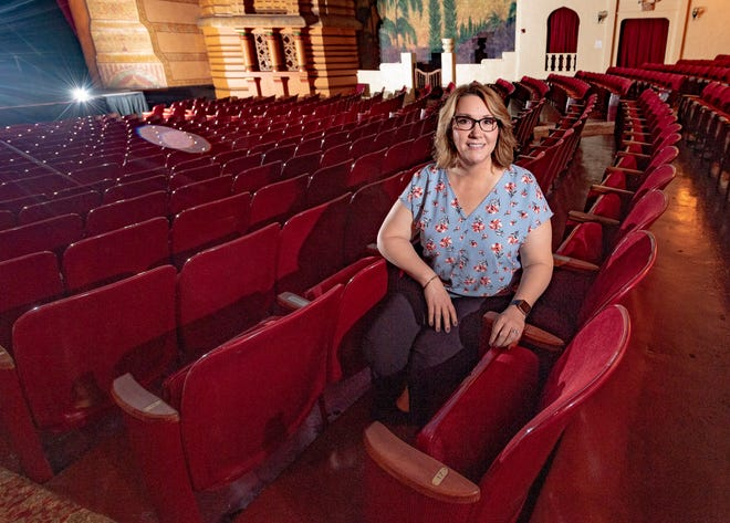 Executive Director Vikky Escobedo sits Monday, August 10, 2020 among seats in the Visalia Fox Theatre that haven't been occupied since March due to COVID-19 concerns.