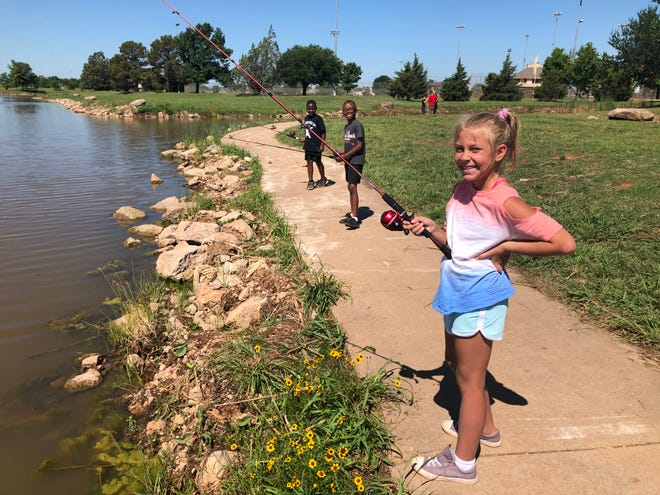Camp Fire participants fish at Plum Lake in Wichita Falls. The after-school program will begin September 8.