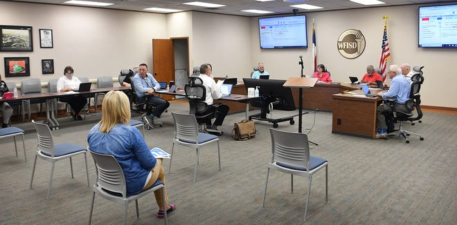 The Wichita Falls ISD board of trustees met Tuesday in their first face-to-face meeting in months to discuss and approve issues related to remote and in-person classes for the approaching school year.
