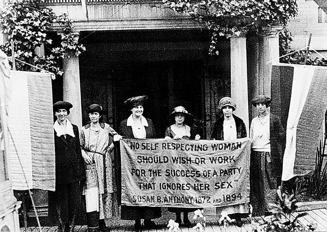 Suffragettes march for the ratification of the 19th Amendment granting women the right to vote at the Republican National Convention in Chicago, June 1920. Chief organizer and author of the Equal Rights Amendment Alice Paul stands second from right.