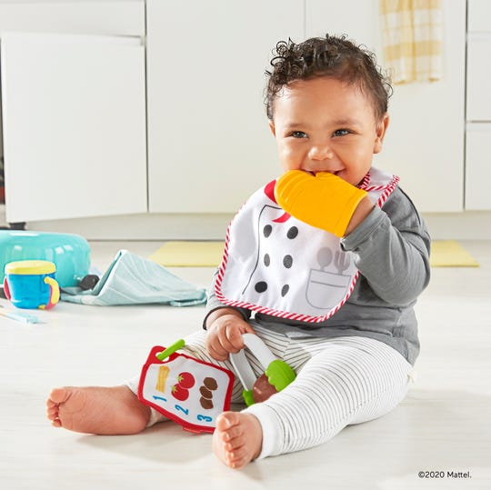 The New Fisher-Price Cutest Chef Gift Set ($14.99, available now) has a chef's apron bib, chewable oven mitt, tongs with a spinning meatball, and a recipe card.