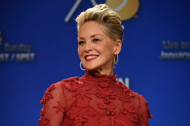 """Sharon Stone poses during the nominations for the 75th Annual Golden Globe Awards on Dec. 11, 2017. Stone has written a memoir her publisher is calling both candid and comprehensive. Alfred A. Knopf announced Tuesday that Stone's """"The Beauty of Living Twice"""" will be released in March."""