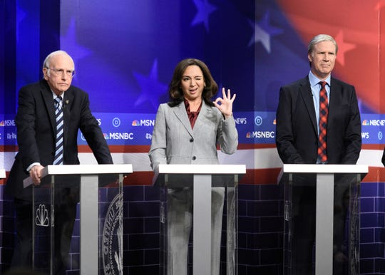 "(l-r) Larry David as Bernie Sanders, Maya Rudolph as Kamala Harris, and host Will Ferrell as Tom Steyer during the ""Democratic Debate"" sketch on ""Saturday Night Live"" on November 23, 2019."