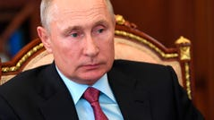 Russian President Vladimir Putin attends a meeting in the Kremlin in Moscow, Russia, Monday, Aug. 10, 2020.