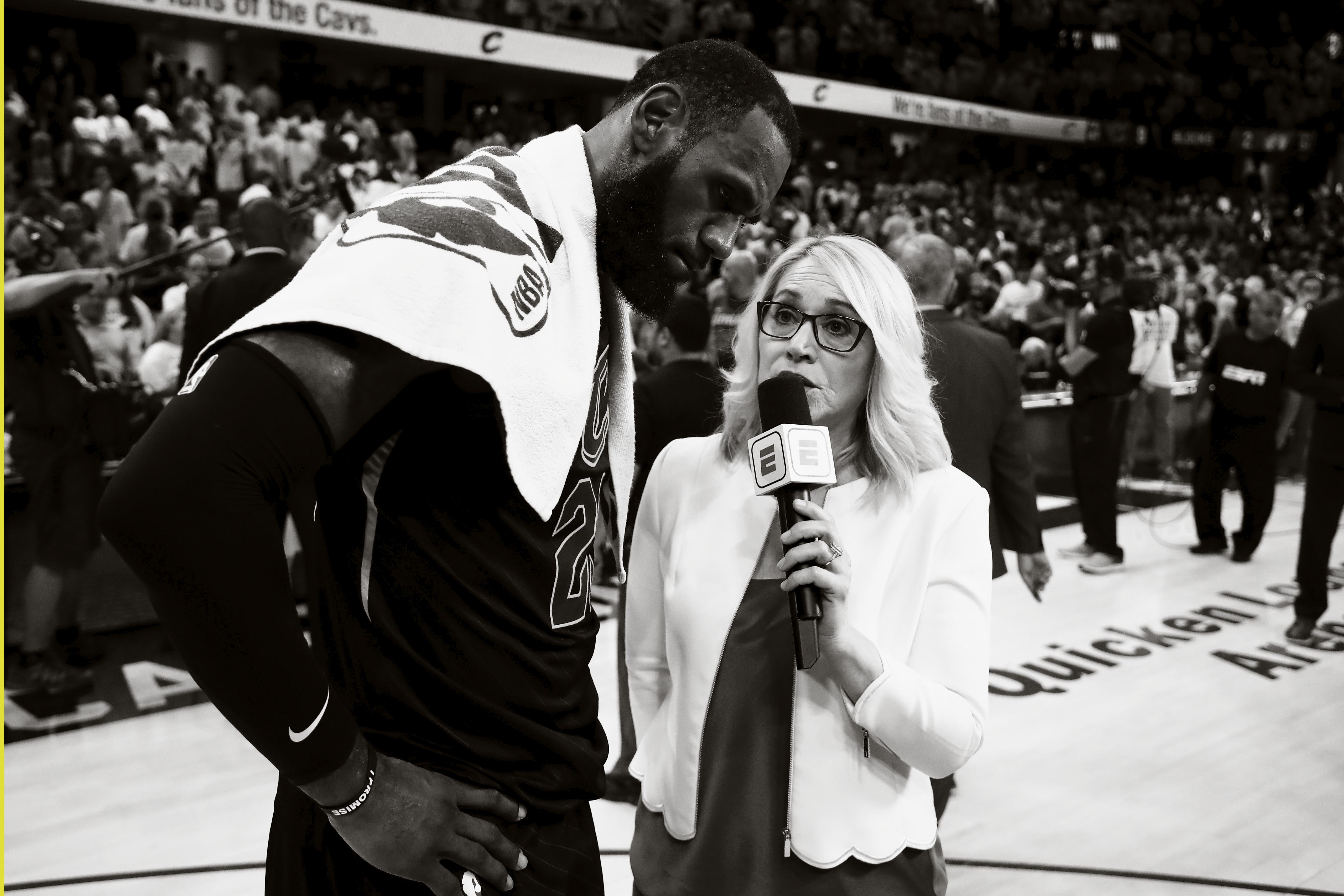 LeBron James speaks to TV personality Doris Burke at the 2018 NBA Eastern Conference Finals in Cleveland, Ohio.