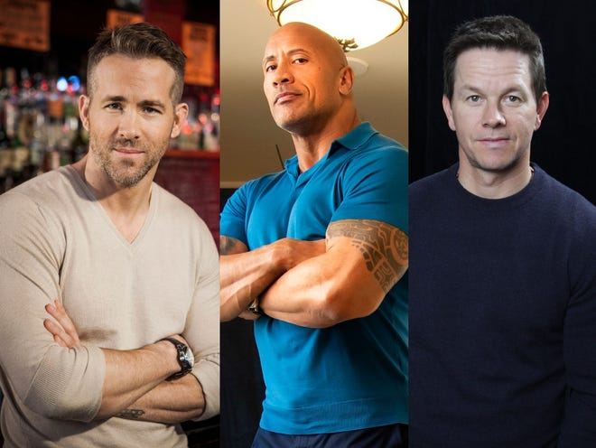 Dwayne Johnson, center, tops the Forbes list of highest-paid actors in 2020. Ryan Reynolds and Mark Wahlberg are the next-highest earners