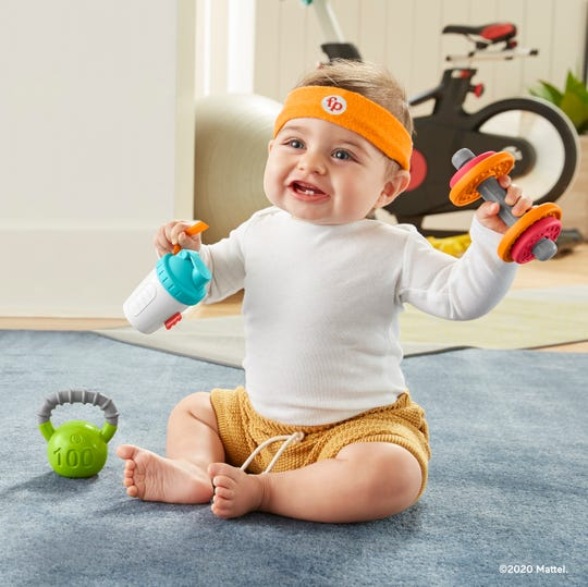 The new Fisher-Price Baby Biceps Gift Set ($14.99, available now) includes a headband, play dumbbell and kettle ball, plus a pretend protein shake drink cup.