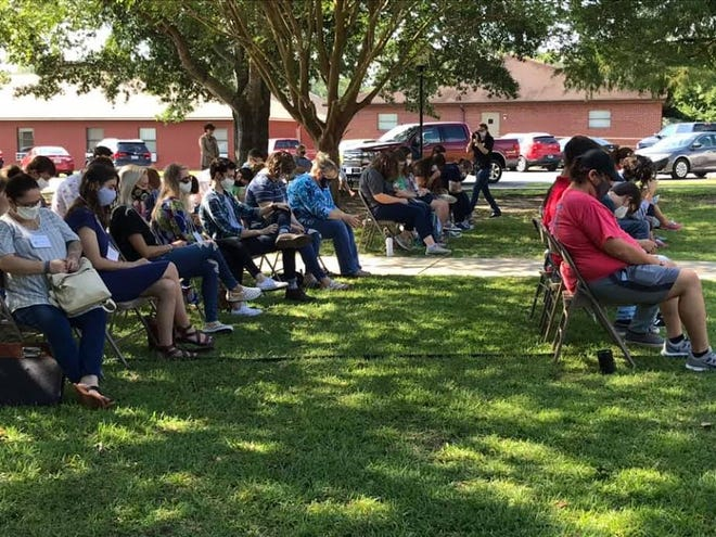 A time of prayer outside with new students and Dr. Kinchen