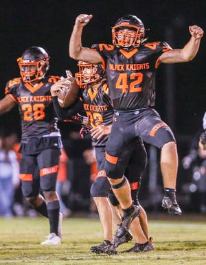 Jake Marion (center) recovers an onside for North Davidson as teammate Tanner Jordan (42) celebrates in a 2019 game with East Davidson. Marion has given a verbal commitment to Army. [Michael Coppley for The Dispatch]