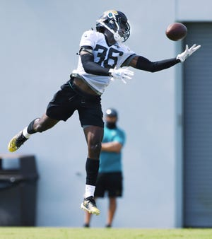 Jaguars #36, safety Ronnie Harrison makes a bobbling one handed catch which ended with a summersault during drills at Wednesday's practice session. The Jacksonville Jaguars practice session at the practice fields outside TIAA Bank Field in Jacksonville, Florida Wednesday August 12, 2020. [Bob Self/Florida Times-Union]