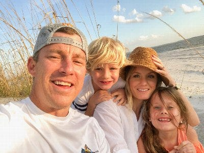 Jacksonville fire engineer Brian McCluney (left), wife Stephanie and their children. [Jacksonville Association of Firefighters]