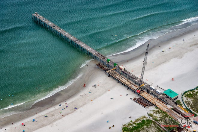 An overhead view of the restoration work on the Jacksonville Beach fishing pier. The project, conducted by Hal Jones Construction, is expected to be complete by early 2022.