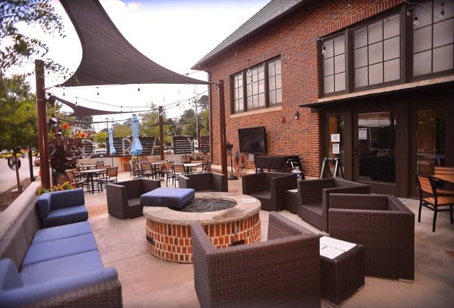 Dray Bar & Grill outdoor dining area at the Drayton Mills Marketplace in the Drayton community of Spartanburg, Wednesday, August 12, 2020.
