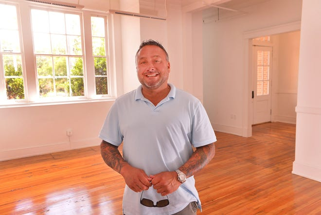 Mark Monroe stands in the new space for Tattoo Lounge at Drayton Mills, a new tattoo shop at the Drayton Mills Marketplace, in Spartanburg, Wednesday, August 12, 2020.