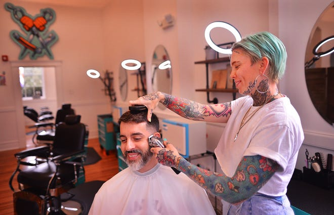 Ashley Rushing, stylist and co-owner of Bareknuckle Barbershop, works with customer Leon Wilkie in the newly-opened shop at the Drayton Mills Marketplace, in the Drayton community of Spartanburg, Wednesday, August 12, 2020.