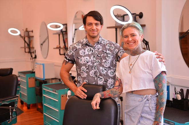 Tyler Maupin and Ashley Rushing, co-owners of Bareknuckle Barbershop, in the newly-opened shop at the Drayton Mills Marketplace, in the Drayton community of Spartanburg, Wednesday, August 12, 2020.