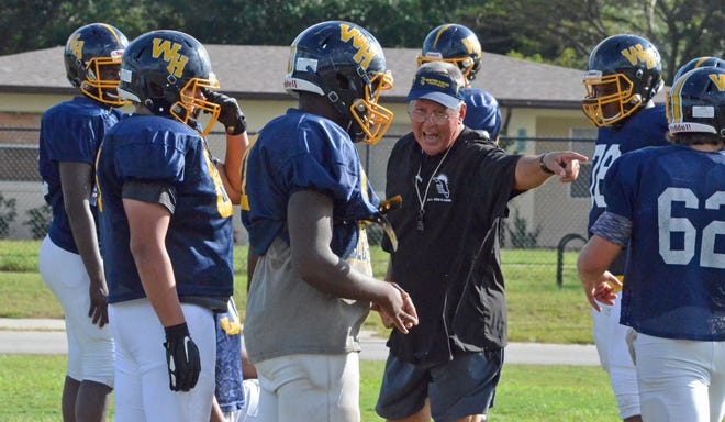 Winter Haven football head coach Charlie Tate gives direction to players during practice last season. Friday's FHSAA board of directors meeting is expected to determine when fall coaches can start practicing and start playing this season. [BILL KEMP/THE LEDGER]
