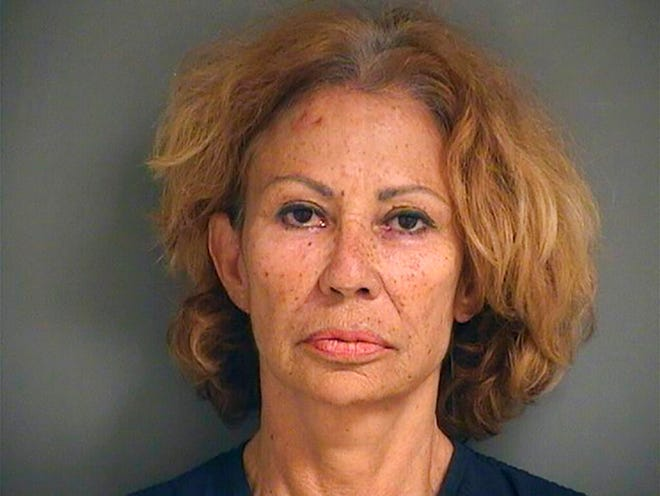 A photo provided by the Palm Beach County Sheriff's Office shows Renata Gloria Ray, who authorities say shot and wounded one woman and threatened another following a confrontation outside a grocery store Sunday afternoon, Aug. 9, 2020, in Lake Worth, Fla. Ray was arrested shortly after the shooting outside a Publix, the Palm Beach County Sheriff's Office said. She was charged with attempted murder and aggravated assault with a firearm. (Palm Beach County Sheriff's Office via AP)