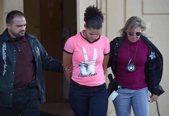 Jada LeBoeuf is walked out to a vehicle to go to booking from the Polk County Sheriff's Operations Center in Winter Haven on Oct. 19, 2017. LeBoeuf was arrested and charged with aggravated manslaughter of a child in the suffocation death of her 8-month-old daughter, Journey LeBoeuf. [FILE PHOTO/THE LEDGER]