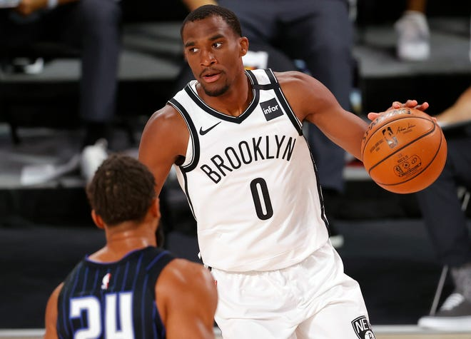 Brooklyn Nets' Jeremiah Martin (0) moves the ball against the Orlando Magic during the first half at of an NBA game Tuesday in Lake Buena Vista.