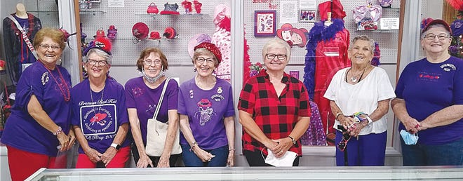 A group of Red Hat ladies from Pratt, (from left) Tamie Pina, Donna Ewing, Janice Meredith, Jeanne Carson, Marsha Giggy, Flo Parsons and Ginny Houdyshell take in a special Red Hat Society exhibit now on display at the Pratt County Historical Museum.