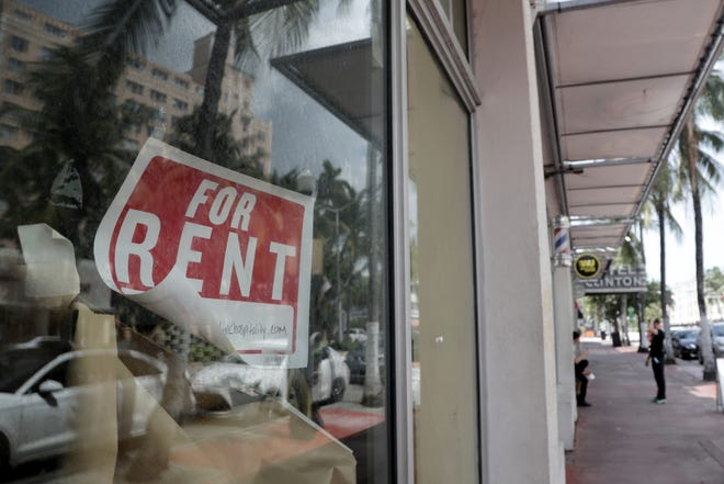 A For Rent sign hangs on a closed shop during the coronavirus pandemic in Miami Beach on July 13. Businesses are being asked to respond to a survey about the economic impact of COVID-19.
