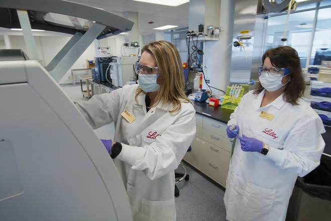 Eli Lilly and Company researchers prepare cells to produce possible COVID-19 antibodies for testing in a laboratory in Indianapolis. Eli Lilly is one of several drugmakers developing treatments for COVID-19.