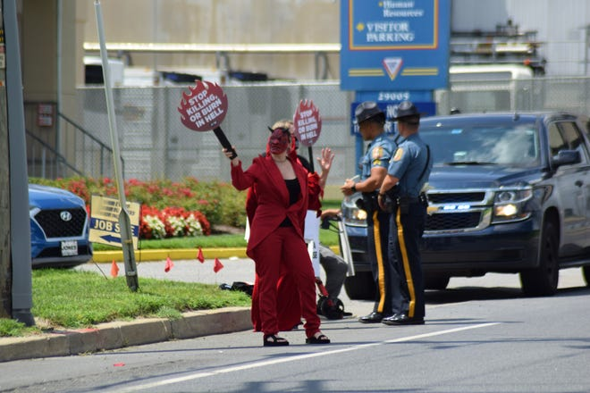 """PETA """"devils"""" protested outside Mountaire Farms on Route 24 in Millsboro on Wednesday, Aug. 12."""