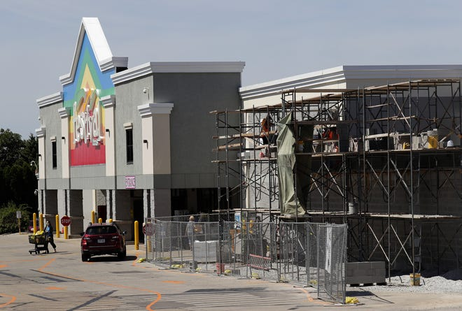 Construction workers are extending a portion of the front of Festival Foods at 1200 W. Northland Ave. in Appleton to accommodate a new fresh food area.