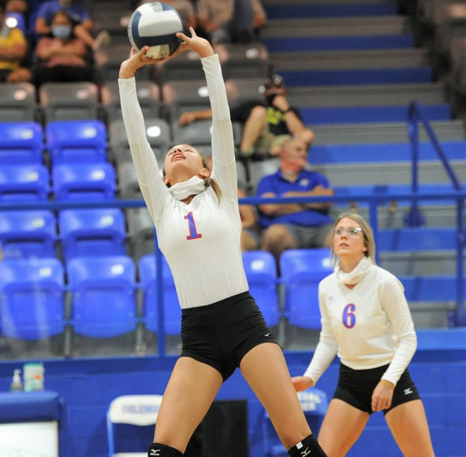 Coleman junior Aislyn Cox sets the ball for a teammate in a match against Bangs on Tuesday, Aug. 11, 2020, at Coleman High School.