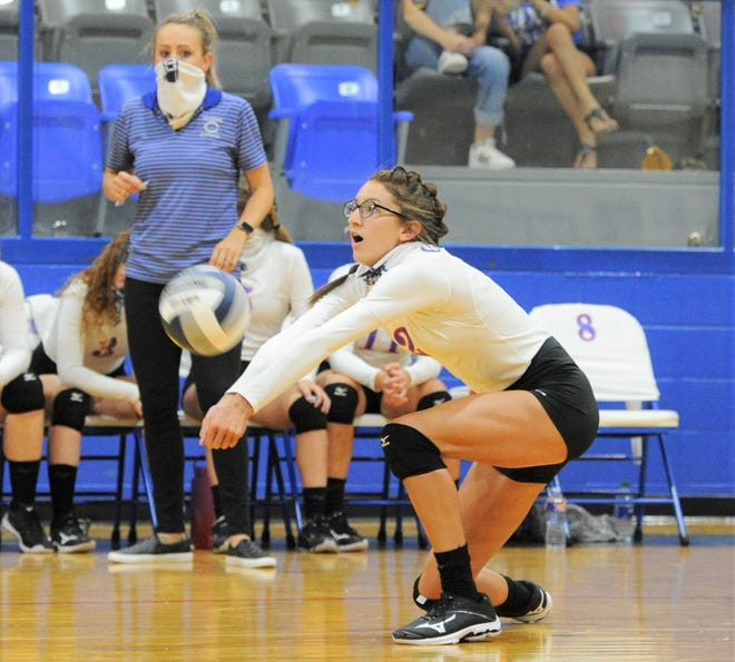 Coleman middle blocker Jordan Rae digs the ball in a match against Bangs on Tuesday, Aug. 11, 2020, at Coleman High School.