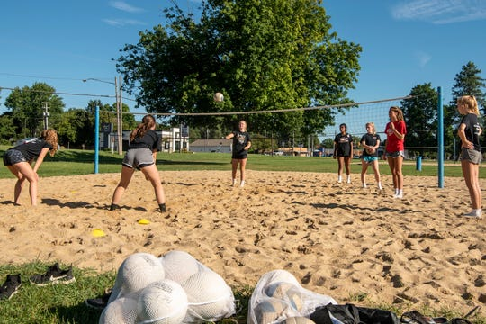 St. Philip volleyball players practice outside at Bailey Park in Battle Creek on Wednesday, August 12, 2020.