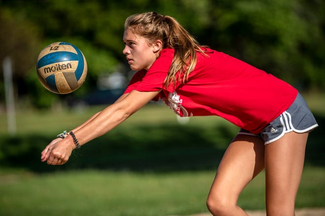 St. Philip junior Brooke Dzwik passes the ball at Bailey Park on Wednesday, Aug. 12, 2020 in Battle Creek, Mich.