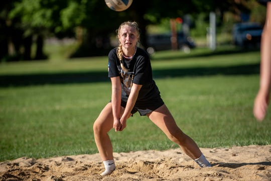 St. Philip Junior Baily Fancher passes the ball at Bailey Park in Battle Creek, Michigan on Wednesday, August 12, 2020.