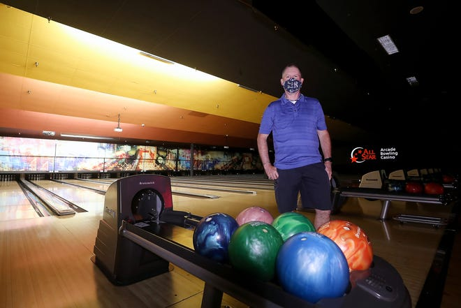Jim Monahan stands among the empty lanes at All Star Lanes & Casino in Silverdale on Wednesday. Bowling alley aren't permitted to reopen until Phase 4 of Washington's reopening plan.