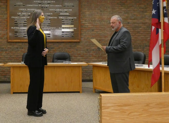 Aaron Sharrock, left, is sworn into office at noon Wednesday by Crawford County Municipal Court Judge Shane Leuthold during a ceremony in council chambers at Bucyrus City Hall.