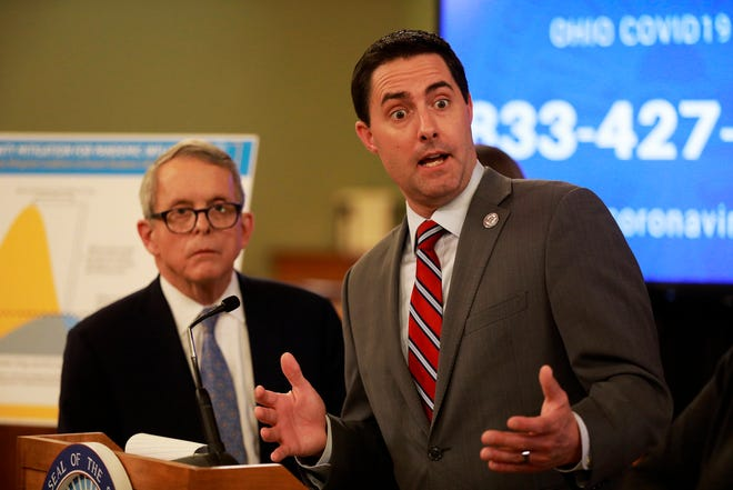 Ohio Secretary of State Frank LaRose answers a reporter's question at a coronavirus news conference in March at the Ohio Statehouse.