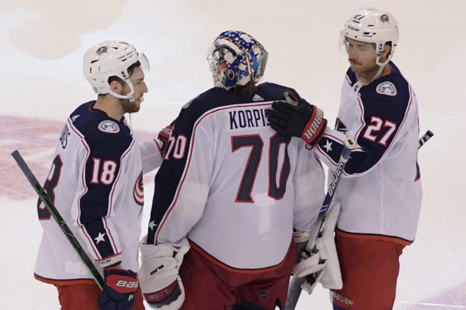 Aug 11, 2020; Toronto, Ontario, CAN;  Columbus Blue Jackets goalie Joonas Korpisalo (70) is consoled by teammates after a 3-2 loss to Tampa Bay Lightning in the fifth overtime period in game one of the first round of the 2020 Stanley Cup Playoffs at Scotiabank Arena.
