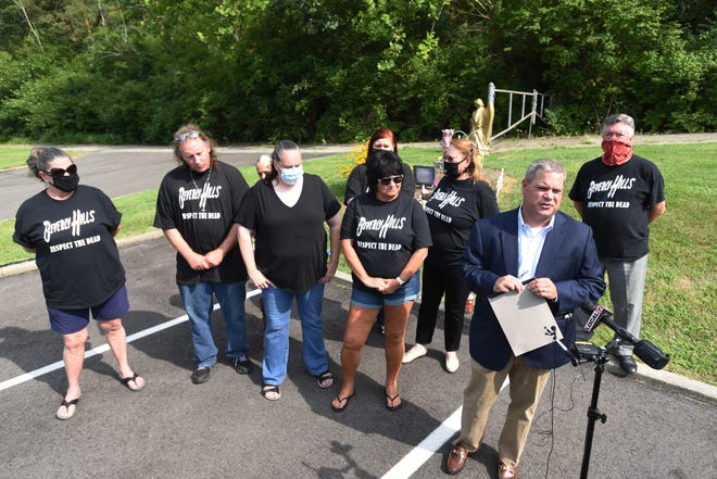 Attorney Steve Megerle leads a press conference with survivors and family members he is representing at the former site of the Beverly Hills Supper Club in Southgate, KY on August 12, 2020