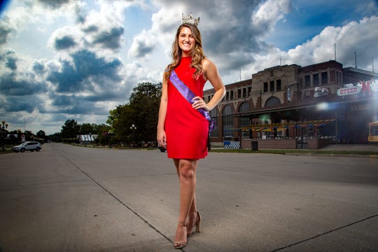 2019 Iowa State Fair Queen Hannah Koellner stands at the fairgrounds on Wednesday, Aug. 12, 2020. Koellner will be the first to serve as the State Fair Queen for two consecutive years.